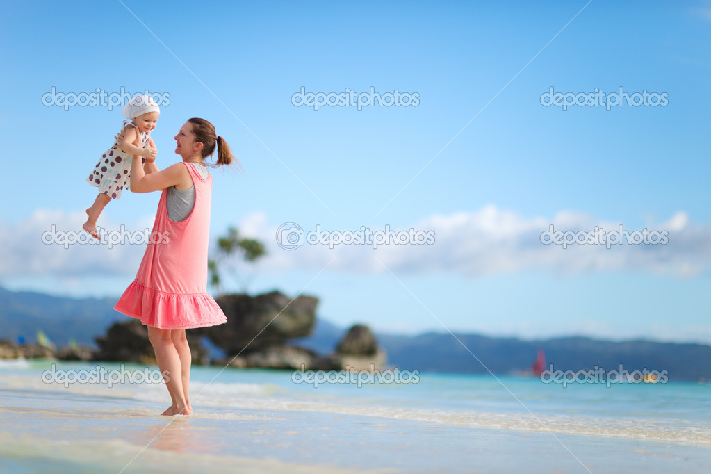 Young mother and her little daughter on tropical white sand beach — Stock Photo #3587099