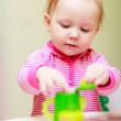 Little girl playing with toys — Stock Photo #3645132