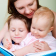 Family reading in bed — Stock Photo #3646211