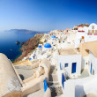 Traditional white and blue village in Santorini - Stock Photo
