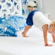 Adorable playful toddler girl in bedroom — Stock Photo #3659045