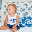 Adorable thoughtful toddler girl in bedroom — Stock Photo