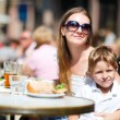 Family having lunch outdoors — Stock Photo #3659106