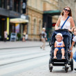 Family walking in city center — Stock Photo