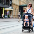 Foto Stock: Family walking in city center