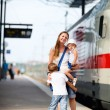 Mother and two kids waiting for train — Stock fotografie