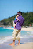 Father and his daughter standing near oceanfront — Stock Photo