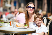 Family having lunch outdoors — Stock Photo