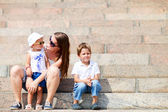 Mother and two kids outdoors — Stock Photo