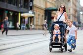 Family walking in city center — Stock Photo
