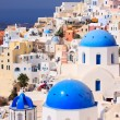 Traditional Greek little town Oia in Santorini - Stock Photo