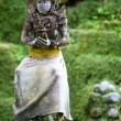 Old beautiful stone Balinese statue — Stock Photo