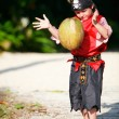 Boy dressed as pirate with coconut - Stockfoto