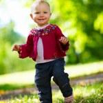 Baby girl walking — Stock Photo