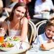 Mother and son having lunch in sidewalk restaurant — Stock Photo