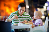 Father and daughter in cafe — Stock Photo