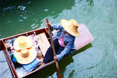 Vendor on traditional floating market in Thailand — Stock Photo