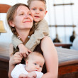 Happy young mother with two kids — Stock Photo #3769754