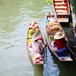 Two vendor on floating market in Thailand - Stock Photo