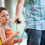 Boy with archery arrows — Stock Photo #3769917