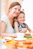 Mother and son having breakfast — Stock Photo