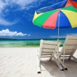 Two beach chairs and colorful umbrella — Foto de Stock