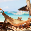 Hammock on tropical beach - Stock Photo