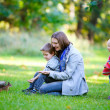 Family and little squirrel in park — Stock Photo #3805497