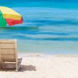 Panorama of tropical beach with chairs and umbrella — Stock Photo