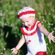 Cheerful toddler girl in meadow — 图库照片