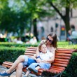 Mother and son sitting outdoors - Stock Photo