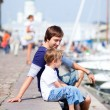 Father and son in city harbor - Stock Photo