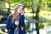 Attractive young woman with mobile phone — Stock Photo
