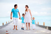 Family walking along jetty — Stok fotoğraf
