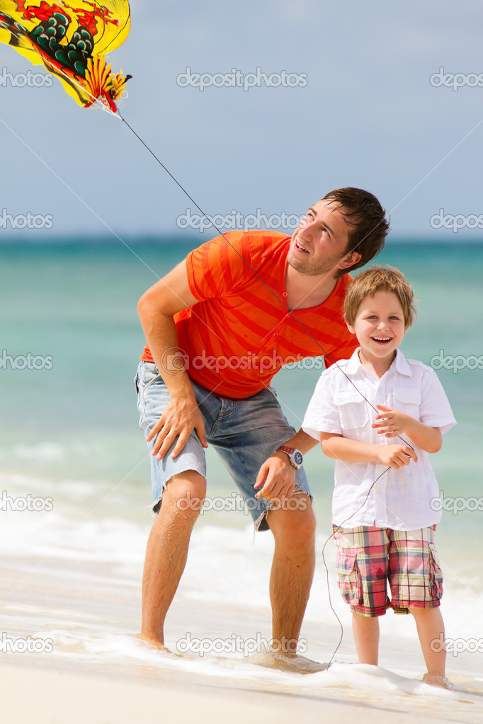 Portrait of happy dad and son flying kite together   Stock Photo #3806828