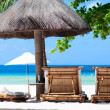 Beach chairs on tropical coast — Stock Photo