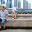 Stock Photo: Two kids at city