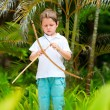 Cute boy playing with bow and arrows — Stock Photo #3856160