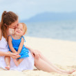 Loving mother and daughter on tropical beach — Stock Photo #3856202