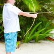 Cute boy playing with bow and arrows — Stock Photo #3856223