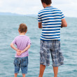 Father and son fishing from pier — Stock Photo