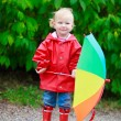 Toddler girl with umbrella outdoors on rainy autumn day — Stock Photo #3856610