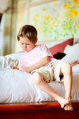 Casual portrait of little boy at home — Stock Photo