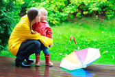 Mother and daughter outdoors at rainy day — Stock Photo