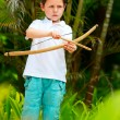 Cute boy playing with bow and arrows — Stock Photo