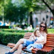 Mother and son on bench in park — Stock Photo