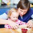 Toddler girl and her dad baking pie — Stock Photo #3903827