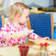 Toddler girl helping at kitchen — Stock Photo #3903835