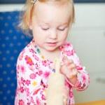 Toddler girl helping at kitchen — Stock Photo #3903856