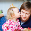 Adorable little girl kissing her father - Stock Photo